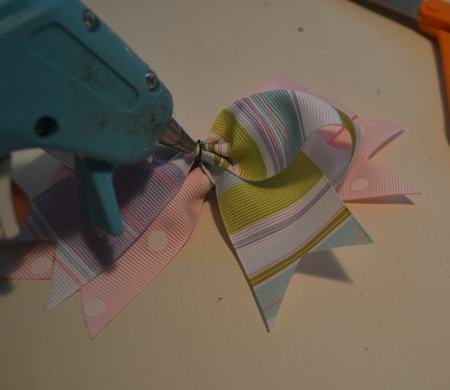 add glue to middle bow and adhere top bow