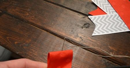 Fold Ribbon and place Needle in the center