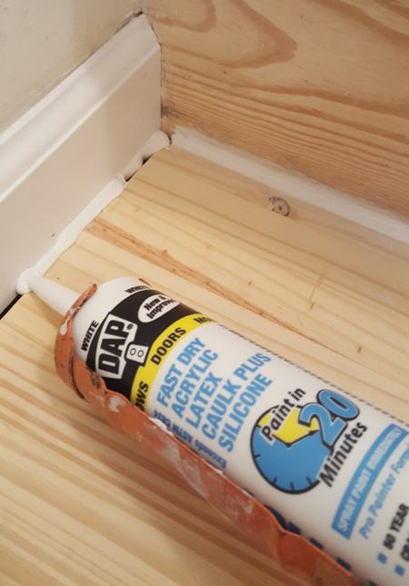 caulk inbetween tread and moulding