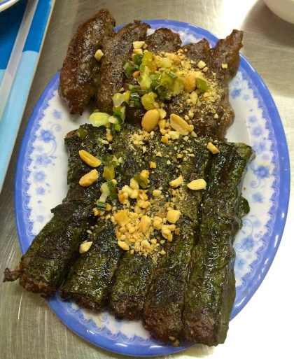 Top: Beef sausages. Bottom: Betel leaves wrapped pork.