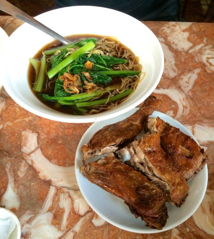 Fried duck and egg noodle soup
