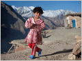 A young girl playing on the roofs of mud houses in the mountain village Sar Agha Seyed, deep in the Zagros mountains, Iran.