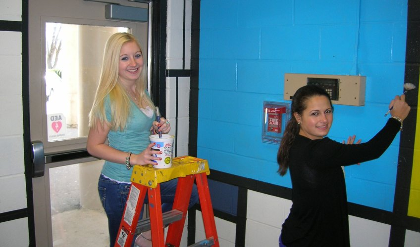 Students paint main lobby in Mondrian style.