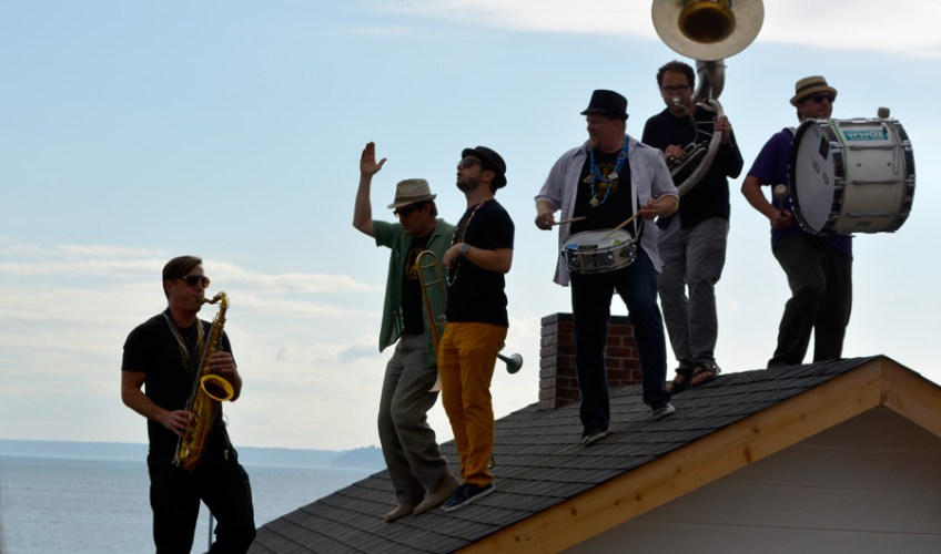 Band playing on the roof of The Western Oracle at the installation opening, Seattle Art Museum sculpture park.