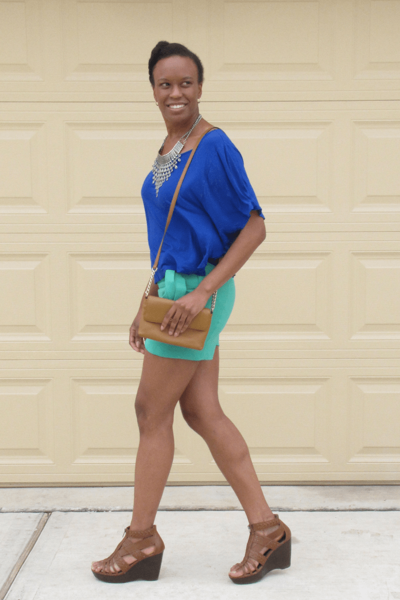 blue blouse and green shorts