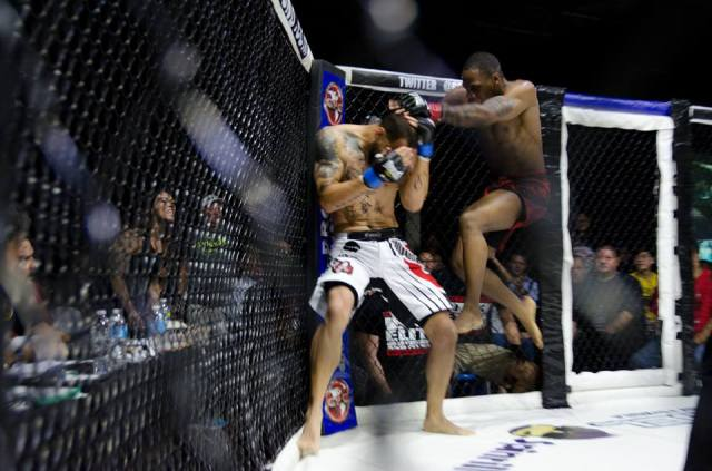 Nah-Shon Burrell lands a flying knee at GPG 24 - Photo by Lance Stein