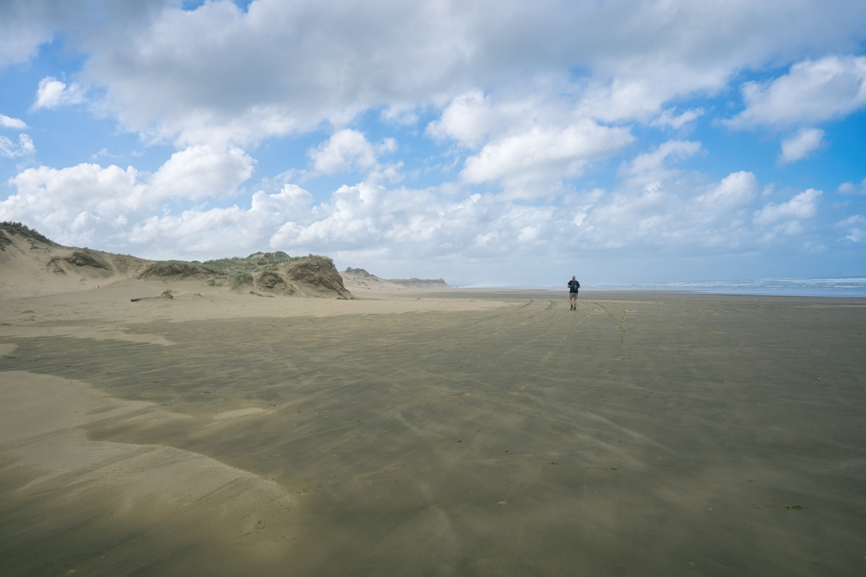 Man Walking On Ninety Mile Beach