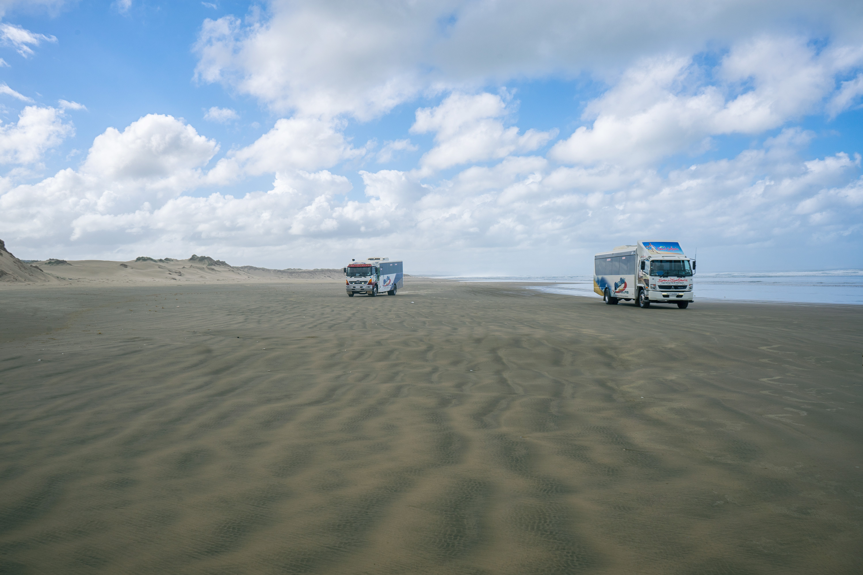 Two Trucks On Ninety Mile Beach
