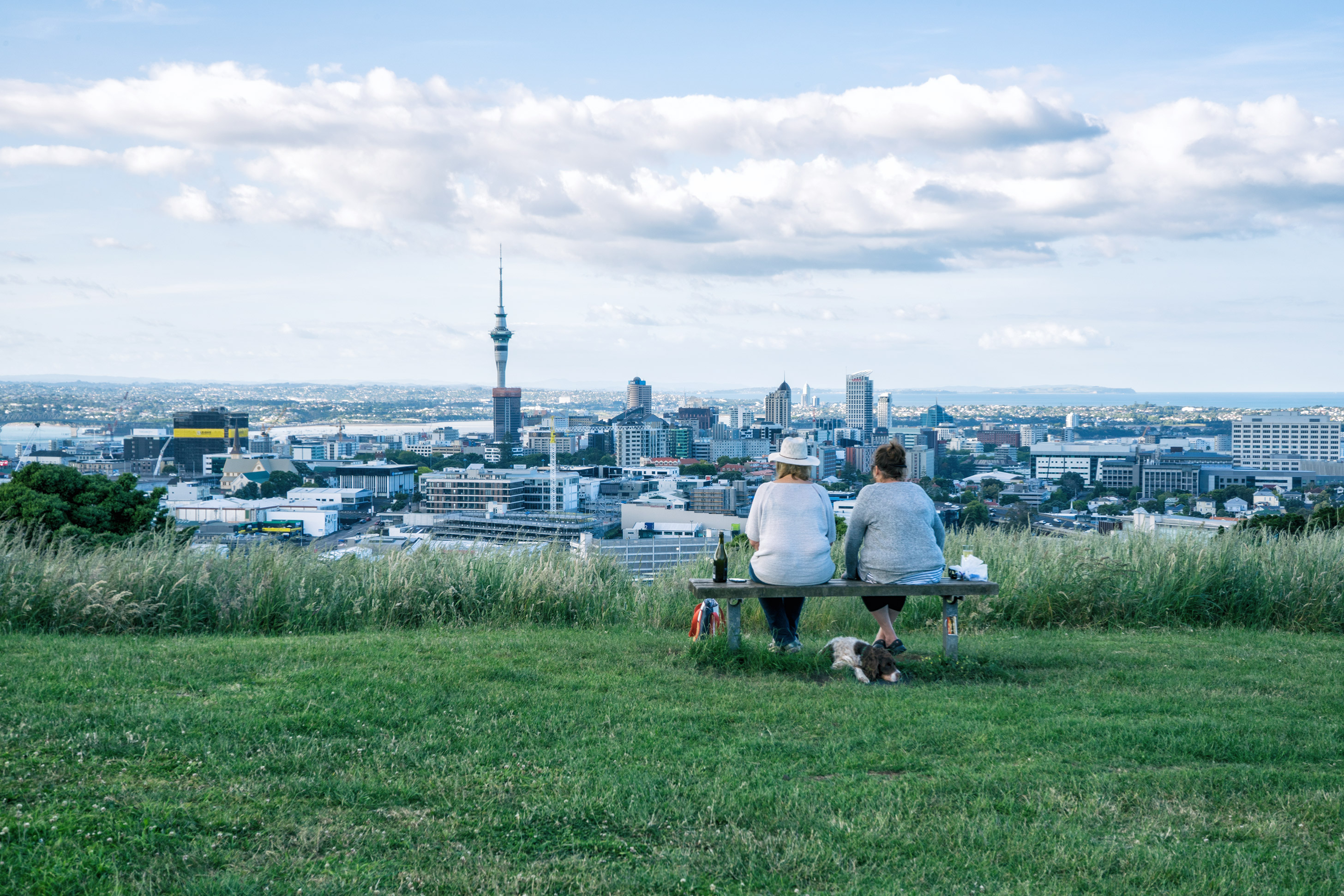 Auckland City View From Mt Eden With Two Women Sitting On Bench In Foreground
