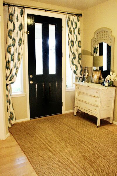 Entryway with dresser and lamp