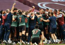 Aston Villa team celebrate survival