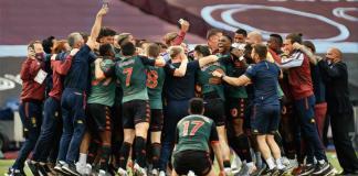 Aston Villa team celebrate survival