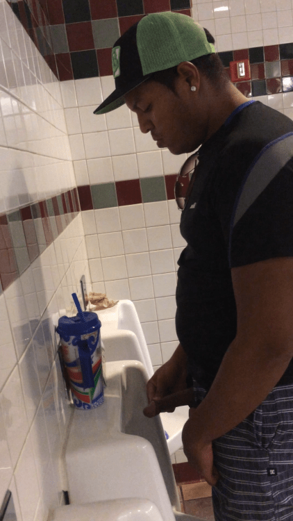 Guys pissing at urinals (2)