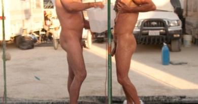Guy-showering-outside