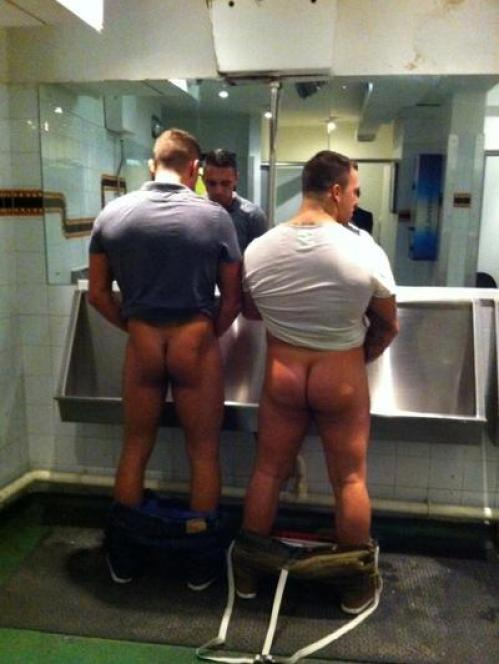 Naked lads pissing
