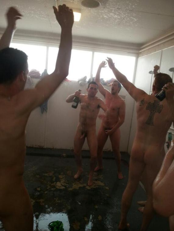 naked sportsmen in showers