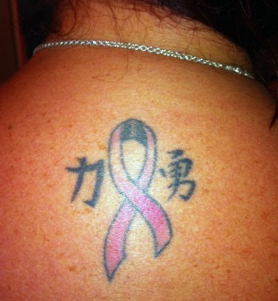 pink ribbon on the nape of her neck