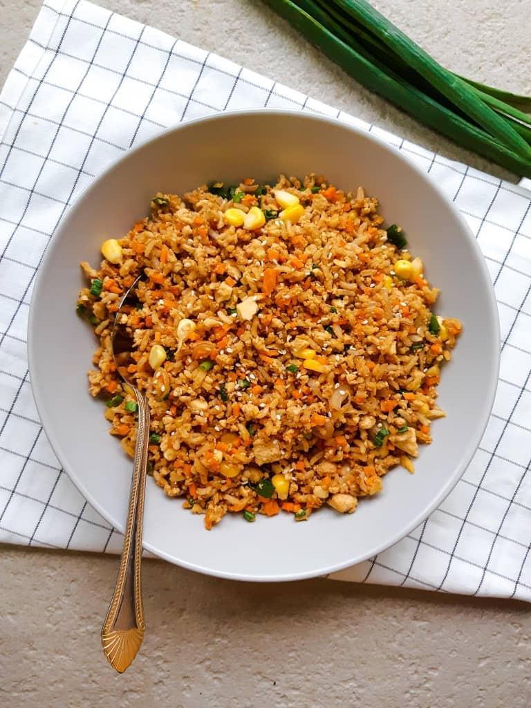 Vegan fried rice in a purple deep plate
