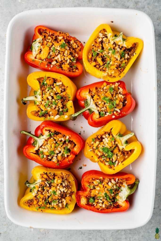 An overhead shot of vegan stuffed peppers in a white casserole