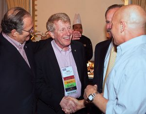 Treleven greets retired CEO (and fellow Hall of Famer) Bob Rosenberg at PestWorld.  Photo: Larry Treleven