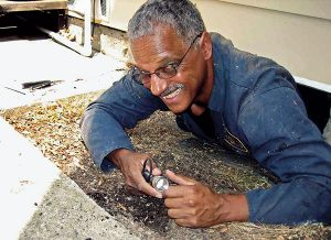 Dr. Vernard Lewis still crawls under the occasional house before retirement. Photo: Dr. Vernard Lewis