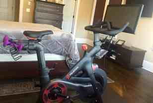 Peloton spin bike with touchscreen and weights