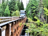 A truck crosses a trestle in the Myra Canyon as part of the Trestle #3 Reconstruction. Photo by Molly Andrian.