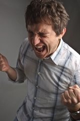 Man screaming in frustration