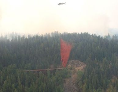 Fire retardent being dumped on Trestle #1. Thanks to heroic efforts by many individuals, it was saved.
