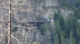 A crane truck working in the Myra Canyon as part of the Trestle #3 Reconstruction. Photo by Molly Andrian.