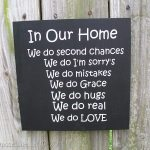 In our Home (sign)