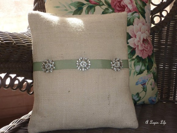 pretty pins for pillows made out of vintage jewelry