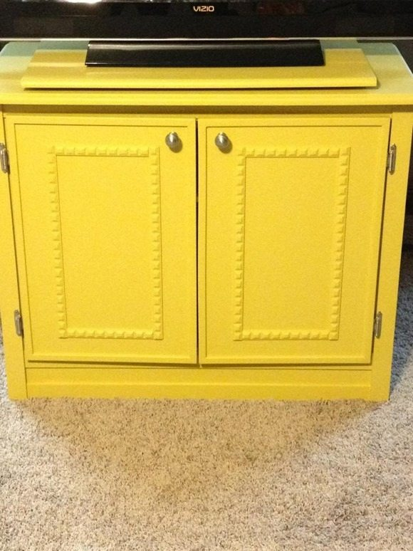 Yellow t.v. cabinet