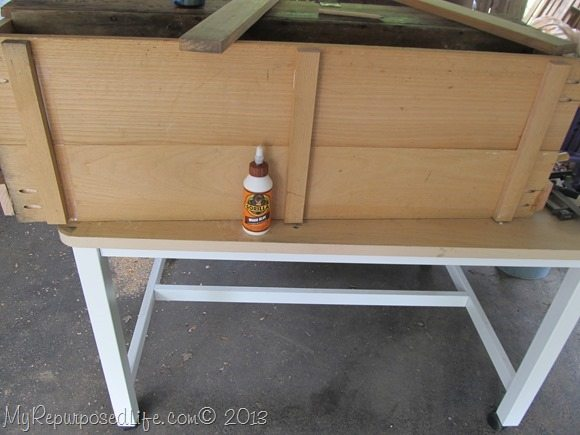 supports glued to bottom shelf