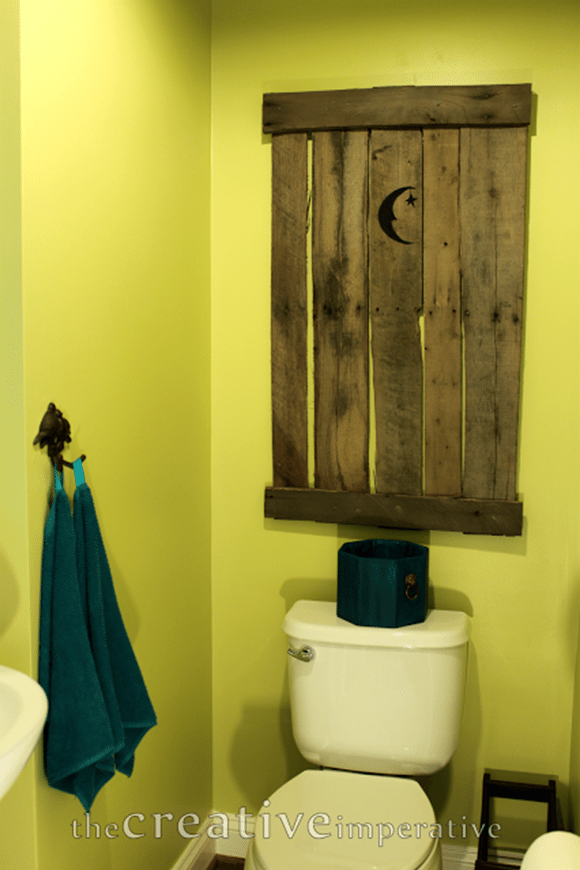 faux outhouse door decor for your powder room