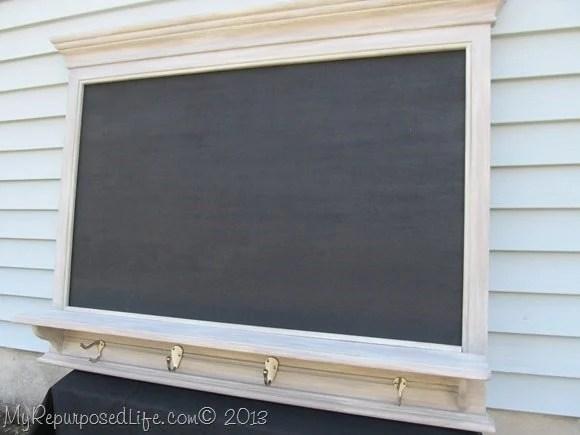 large chalkboard with shelf and hooks