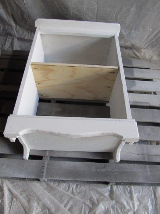 spray paint underside of old nightstand cabinet