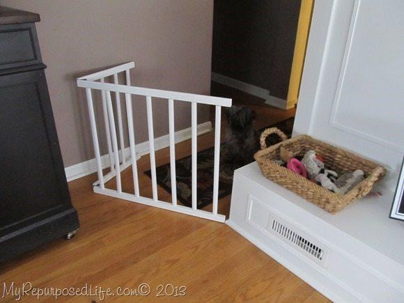 repurposed crib rails make a diy doggie gate