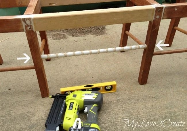 using a crib spindle on the front of the bench