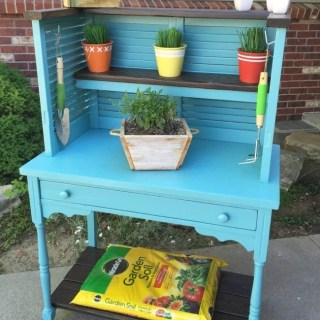 shutters and desk repurposed into potting bench