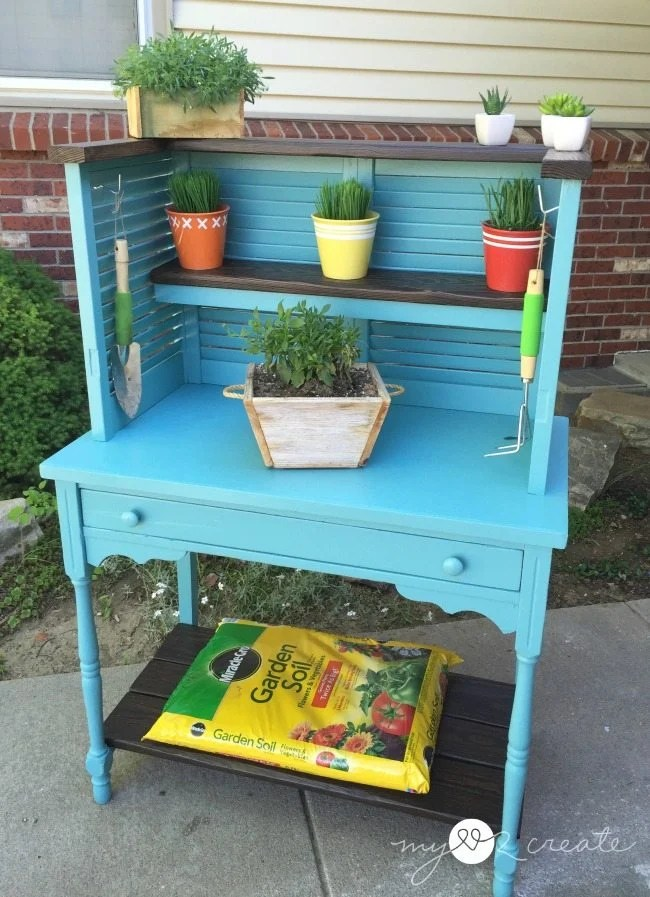 shudders and desk repurposed into potting bench