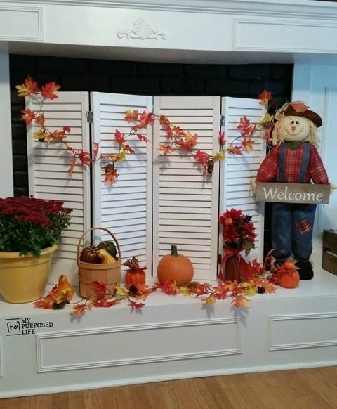 DIY fireplace screen made from old shutters or bi-folding doors