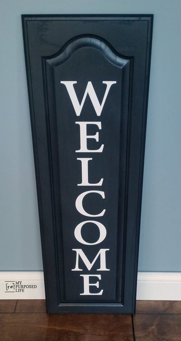converted cabinet door into a large welcome sign