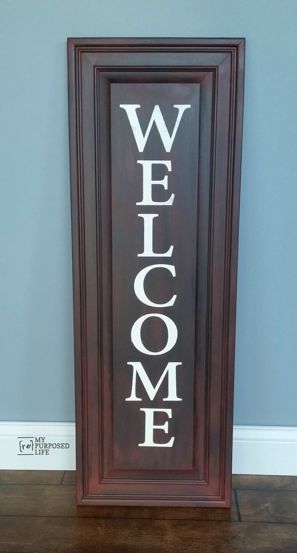 My Repurposed Life easy WELCOME sign using an old cabinet door