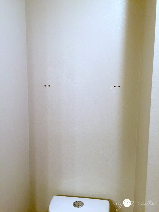 bathroom wall before reclaimed wood shelves