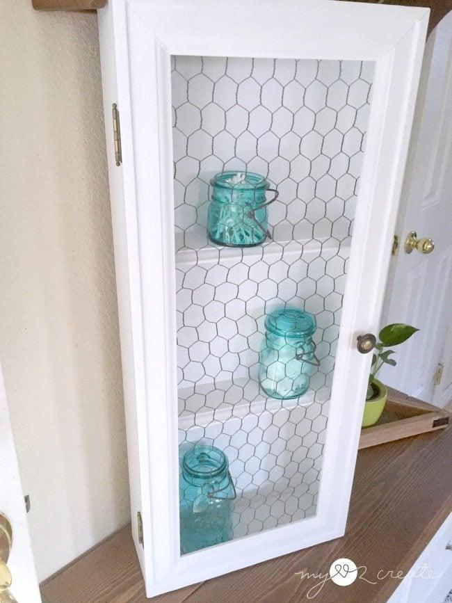 old drawer cabinet with chicken wire door MyLove2Create for MyRepurposedLife.com