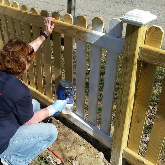 using a paint sprayer on outdoor projects such as a picket fence