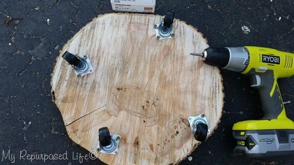 wheels on rolling wood slice plant stand