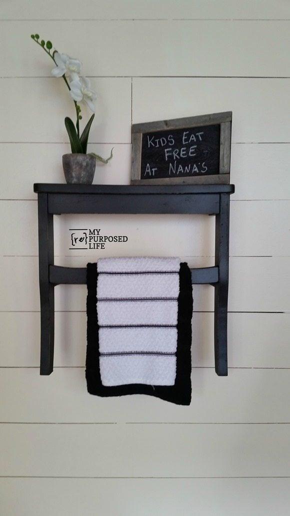 black kitchen towel rack shelf using repurposed chair seat MyRepurposedLife.com