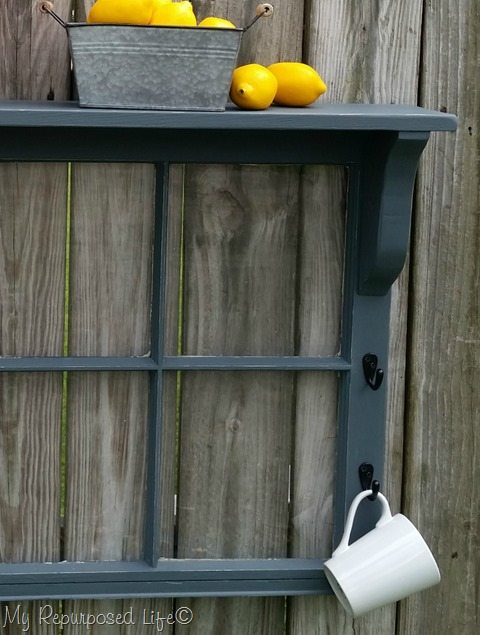 gray window shelf with coffee cup and lemons